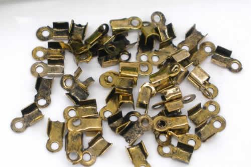 20 stuks koordklem oud goudkleurig