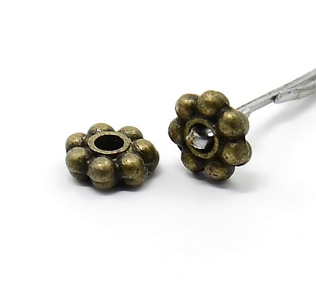 1000 stuks spacer/rondel brons 4 mm